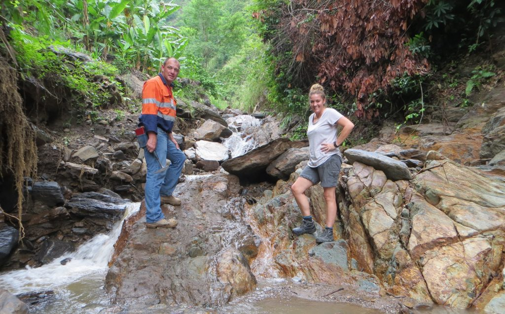 Darryl Mapleson and colleague standing on rocks by stream