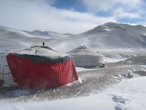 Yurts in bleak mountain terrain
